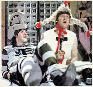 Paul McCartney and John Lennon in fancy dress costumes, 1960s.